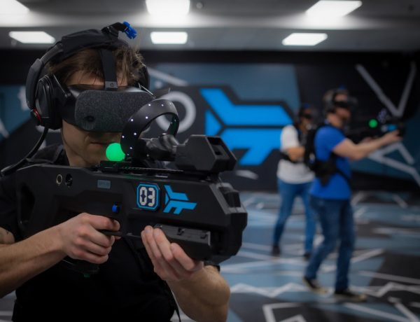 Man with VR headset and gun